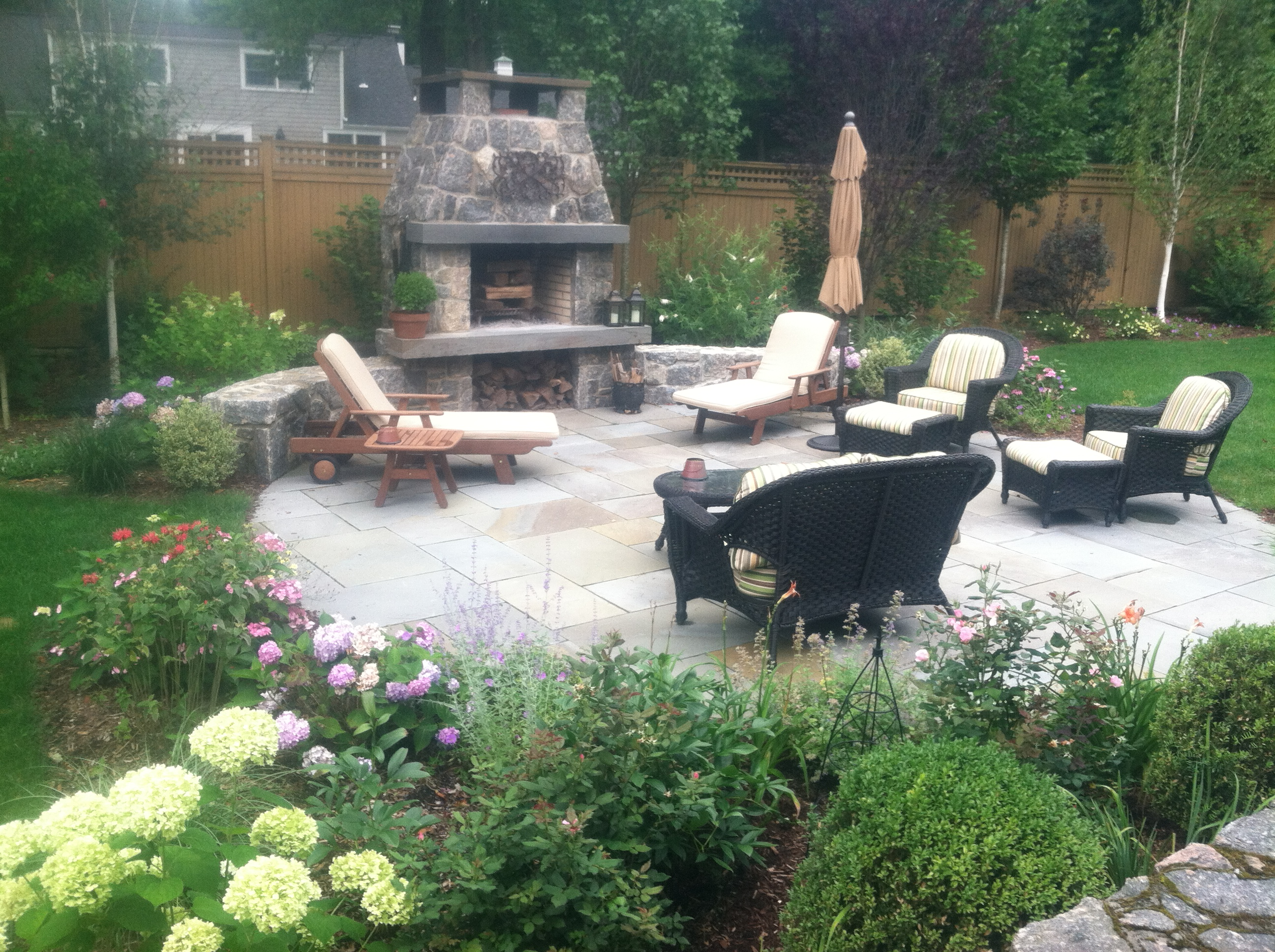 """stone_fireplace_with_flagstone_patio"""
